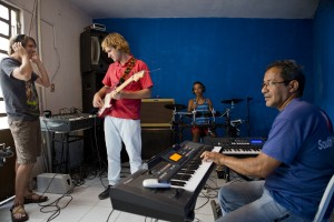 Jordan recording a traditional Brazilian song, performed by the Touch of the Master music school staff.