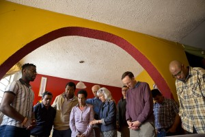 Praying over a family after enjoying lunch at some church members' house in Lima.
